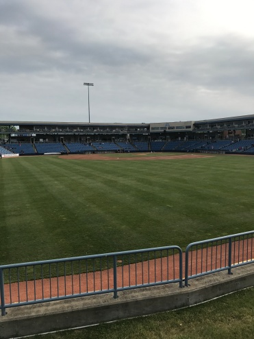 A view of the stadium from the outfield grass.