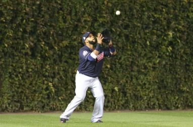 Carlos Santana, the Indians DH, playing outfield at Wrigley Field during the World Series.