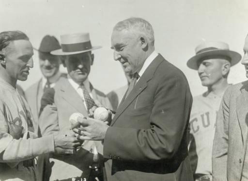 Warren-Signing-Baseballs